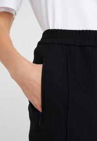 Marc Cain - Pantalon classique - black - 4