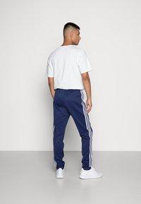 adidas Originals - Tracksuit bottoms - night sky/white - 2