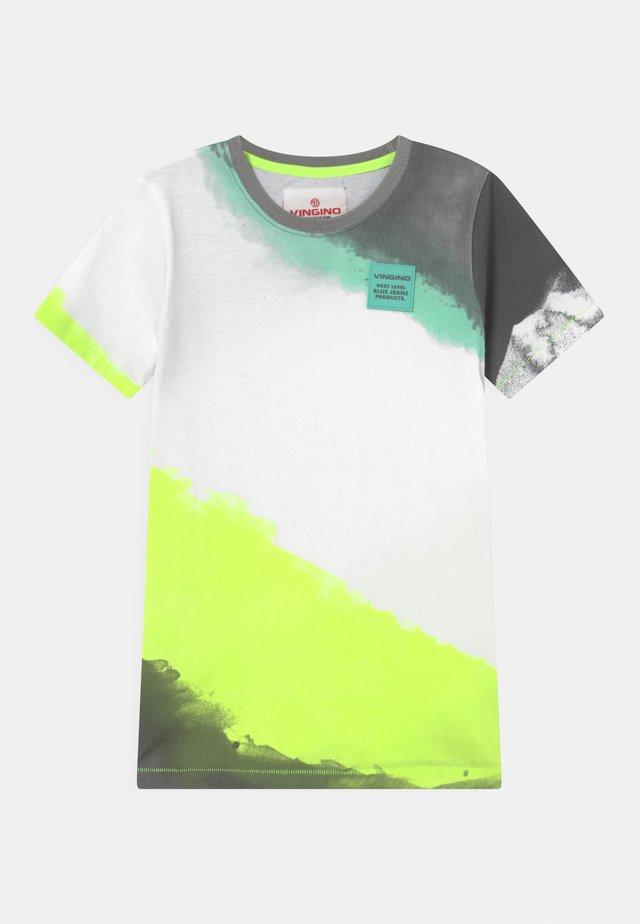 HASTI - Print T-shirt - chill yellow
