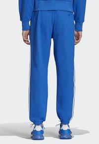 adidas Originals - NINJA PANT UNISEX - Tracksuit bottoms - blue - 2