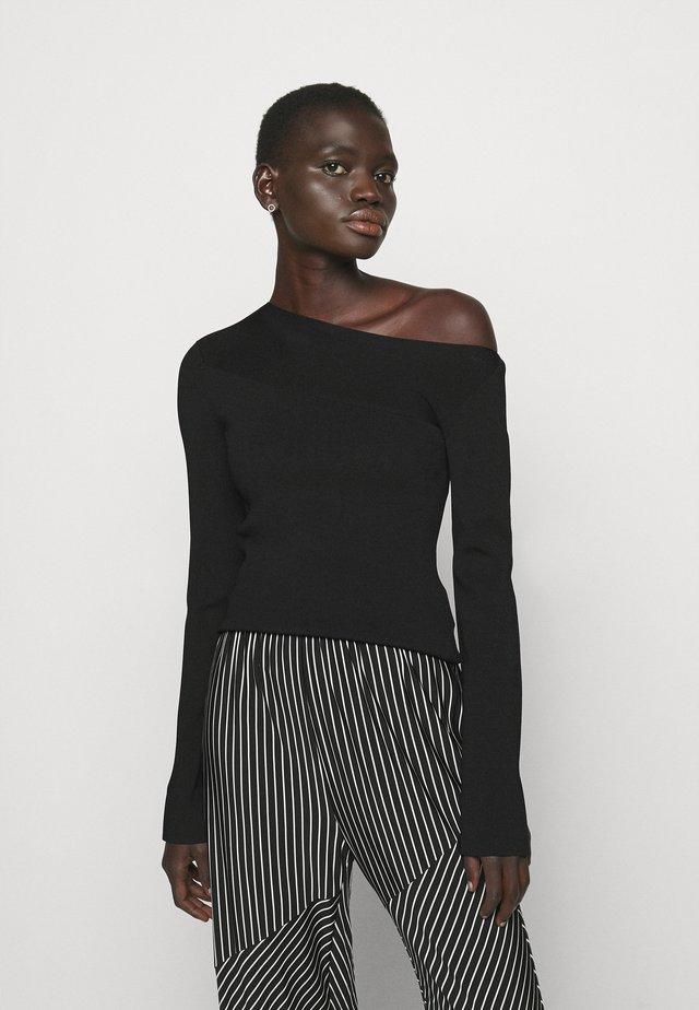 ASYMMETRIC - Pullover - black