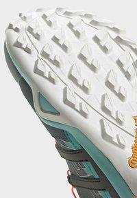 adidas Performance - TERREX SWIFT R2 HIKING SHOES - Hiking shoes - green - 7