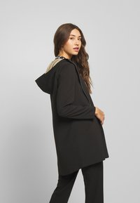 Vero Moda - VMDORITUPTOWN JACKET  - Classic coat - black - 2