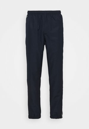 TENNIS PANT TAPERED - Verryttelyhousut - navy blue/white