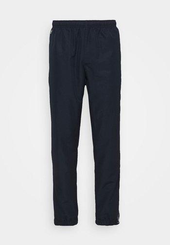 TENNIS PANT TAPERED - Träningsbyxor - navy blue/white