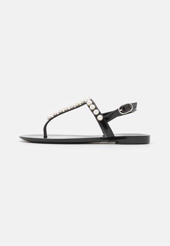 GOLDIE - T-bar sandals - black