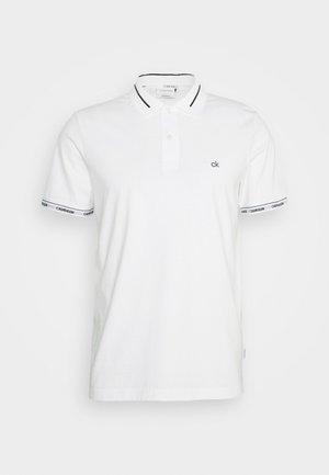 LIQUID TOUCH LOGO CUFF  - Polo shirt - white