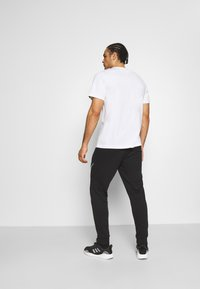 adidas Performance - FAVS  - Tracksuit bottoms - black/white - 2