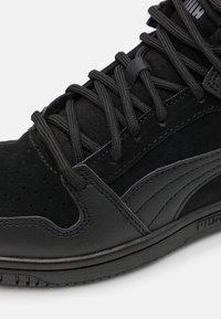 Puma - REBOUND LAYUP UNISEX - Sneakers high - black/castlerock - 5