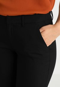 s.Oliver - SHAPE ANKLE - Trousers - black - 5