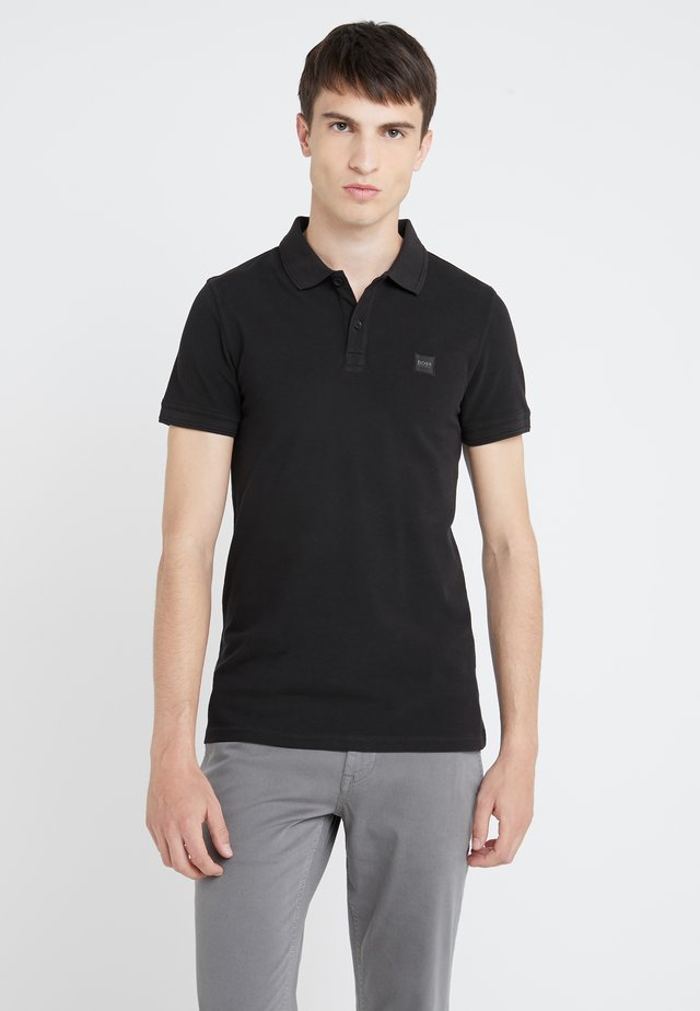 PRIME - Polo shirt - black