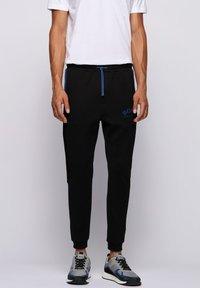 BOSS - HADIKO - Pantaloni sportivi - black - 0