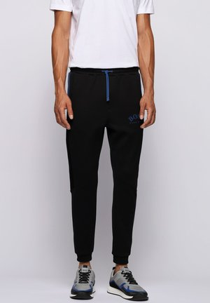HADIKO - Tracksuit bottoms - black
