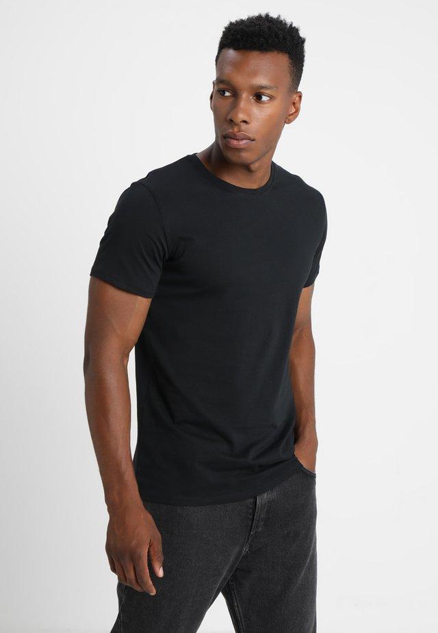 ROCK SOLID - T-shirt basic - black