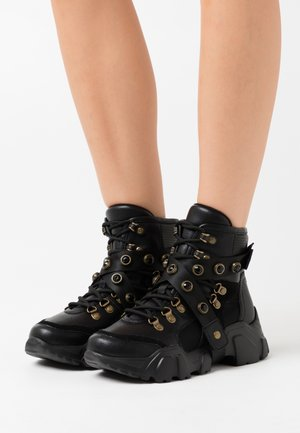 Platform ankle boots - black