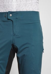 Patagonia - DIRT ROAMER STORM PANTS - Trousers - crater blue