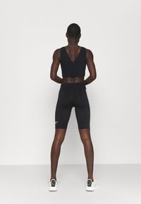 Reebok - PERFORM CROP - Top - black