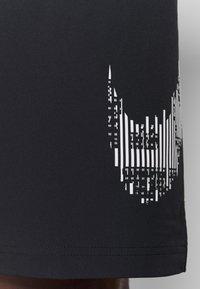 Nike Performance - M FLX GFX - Sports shorts - black - 5