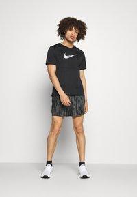Nike Performance - SHORT - Sports shorts - black - 1