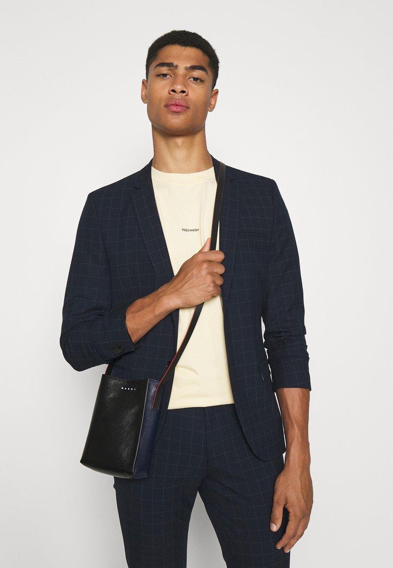 Marni - MUSEO SOFT SHOULDER - Across body bag - black/navy blue