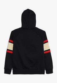 Nike Sportswear - AIR  - Zip-up hoodie - black/team gold/university red - 1