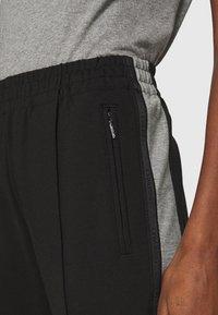 Calvin Klein - MILANO PANTS - Teplákové kalhoty - black - 5