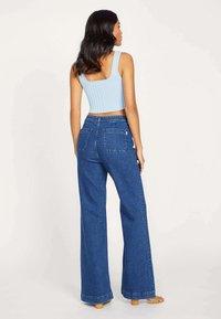Kookai - ROMANTIQUE - Flared Jeans - yn-brut - 1