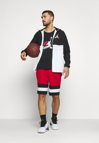 Jordan - WINDWEAR - Windbreaker - black/white/gym red - 1