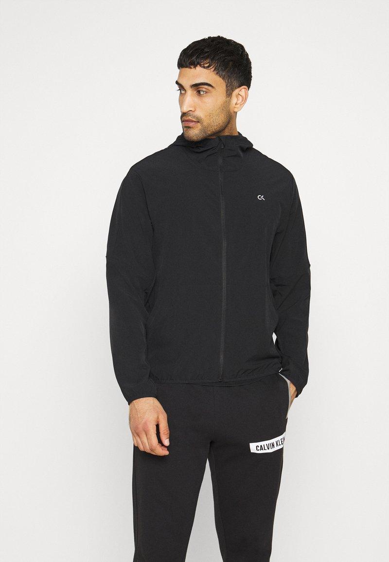 Calvin Klein Performance - MIX FABRIC WINDJACKET - Träningsjacka - black