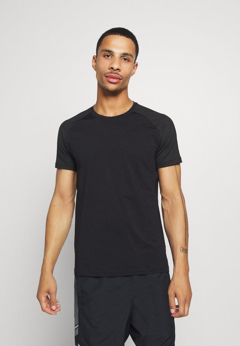 Casall - STRUCTURED TEE - Jednoduché triko - black