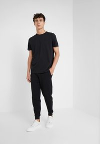HUGO - DOAK - Tracksuit bottoms - black - 1