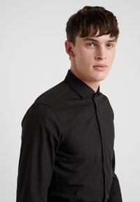 HUGO - ERRIKO EXTRA SLIM FIT - Formal shirt - black - 3