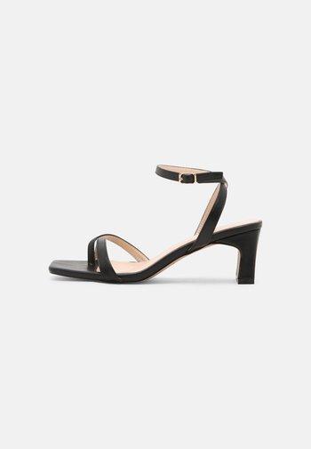 STARLIN - Sandals - black