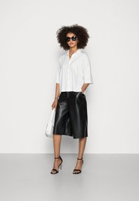 Marc O'Polo - JERSEY BLOUSE  SMALL STAND UP COLLAR BUTTON CLOSURE - Button-down blouse - white - 1