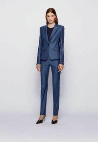 BOSS - TITANA - Pantaloni - blue - 1