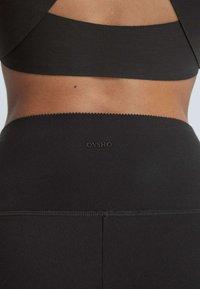 OYSHO - Tracksuit bottoms - black - 4