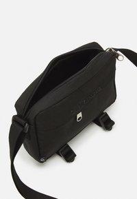 Calvin Klein Jeans - PRIDE UTILITY CAMERA BAG - Across body bag - black - 2