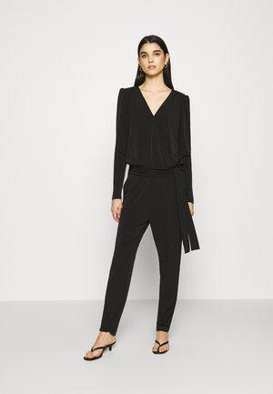 LAUGA - Jumpsuit - black