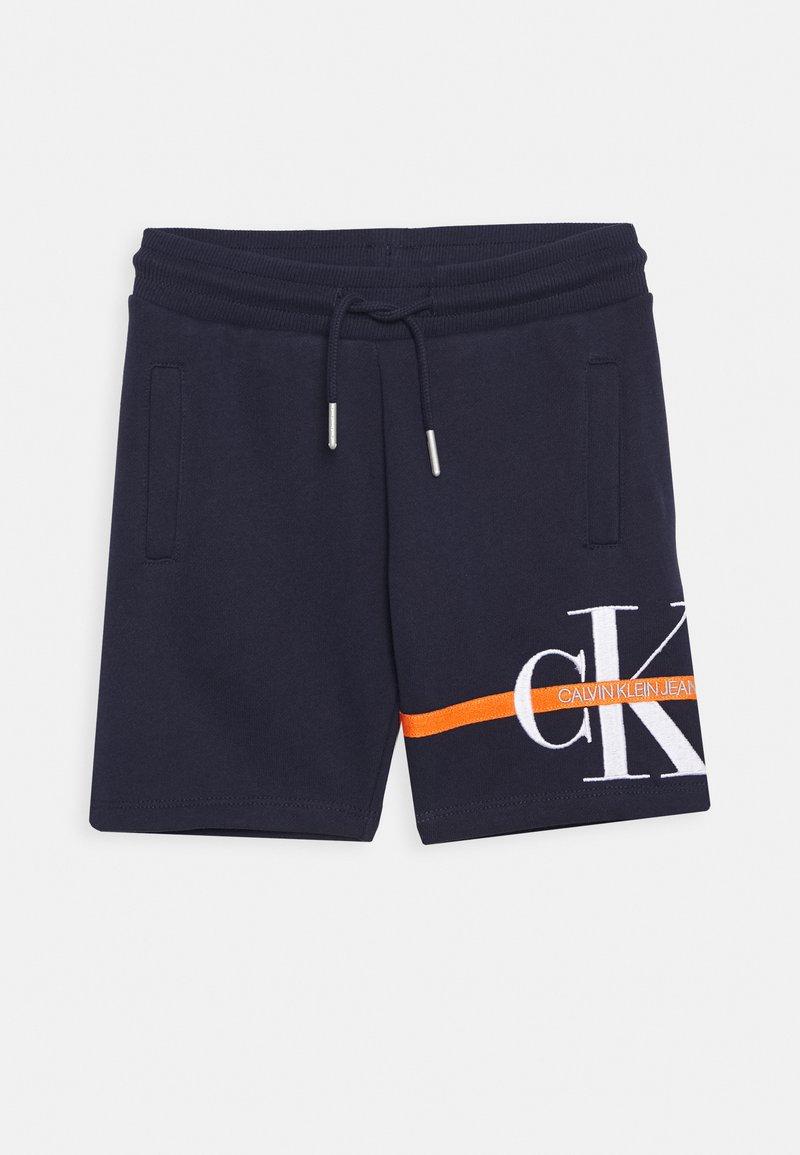 Calvin Klein Jeans - MONOGRAM STRIPE - Tracksuit bottoms - blue