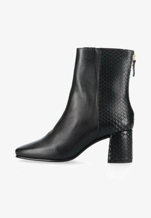 Korte laarzen - schwarz multi