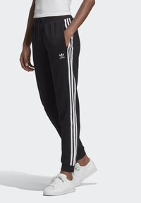 adidas Originals - SLIM CUFFED JOGGERS - Tracksuit bottoms - black - 0