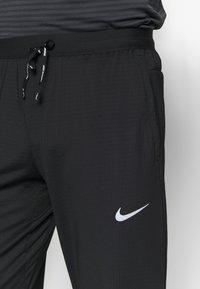 Nike Performance - ELITE PANT - Teplákové kalhoty - black/reflective silver - 3