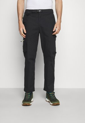 TOBY - Trousers - black