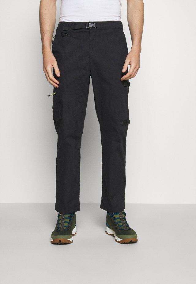 TOBY - Pantalon classique - black