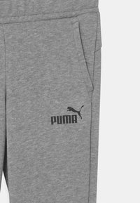Puma - LOGO UNISEX - Tracksuit bottoms - medium gray heather - 2