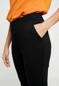 Modström - TANNY PANTS - Trousers - black - 4