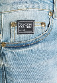 Versace Jeans Couture - AMETIST - Slim fit jeans - light blue denim - 7