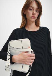 Calvin Klein - FLAP SHOULDER BAG - Handbag - white - 1