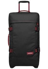 Eastpak - TRANVERZ M - Wheeled suitcase - blakoutstripred - 0