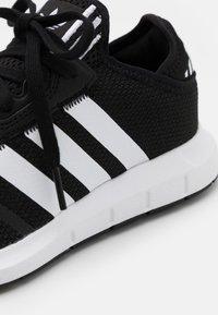 adidas Originals - SWIFT RUN X UNISEX - Trainers - core black/footwear white - 5